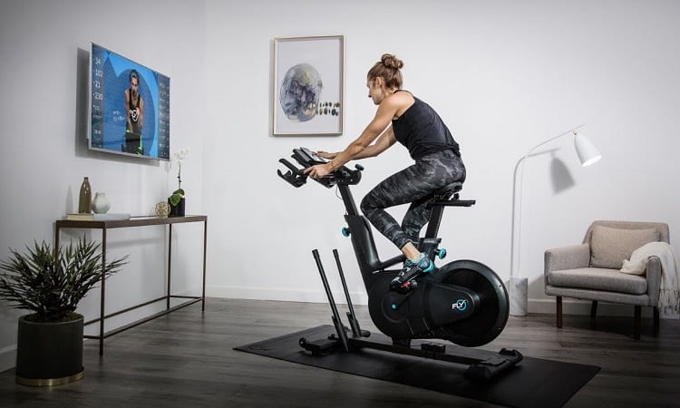 How do indoor exercises compare to actual bike riding?