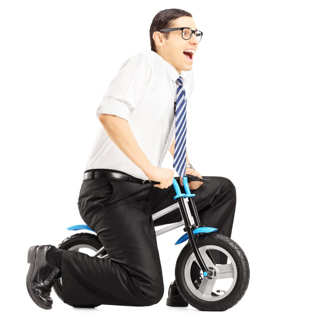photo of adult on too small of a bike