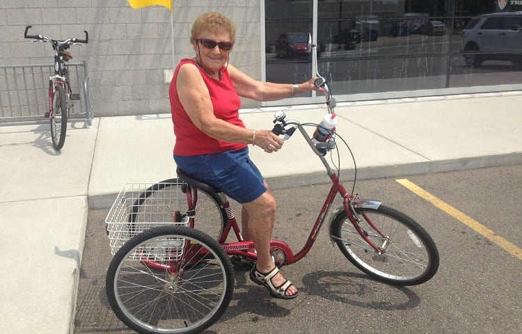 senior woman riding tricycle