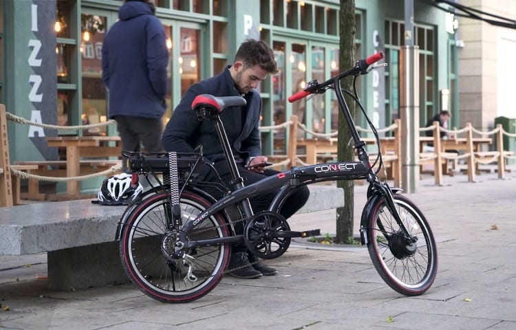 young man with his folding cycle