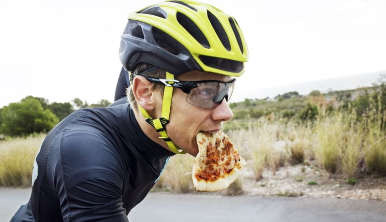 Cyclist Eating Pizza
